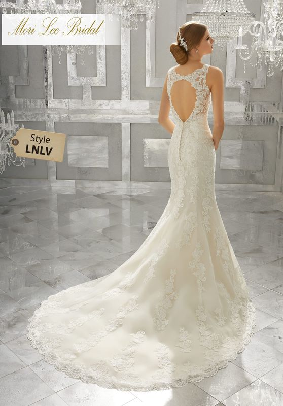 Style LNLV Meya Wedding Dress  Romantic Frosted Alençon Lace Appliqués Create A Soft and Feminine Fit and Flare Wedding Gown. Scalloped Hemline Lace Complete and Open Keyhole Back Complete the Look. Shown with Detachable Tulle Train (not included), Sold Separately as Style NXOEZ. Available in Three Lengths: 55″, 58″, 61″. Colors Available: White, Ivory, Ivory/Light Gold.