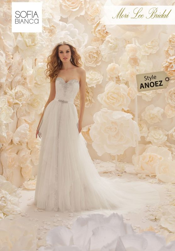 Style ANOEZ A STRAPLESS SLIM FIT LACE DRESS WITH DIAMANTE NECKLINE AND A REMOVABLE TULLE OVERSKIRT CREATING TWO UNIQUE BRIDAL LOOKS  AVAILABLE IN 3 LENGTHS: 55', 58' AND 61'  COLOURS WHITE, IVORY OR IVORY / BLUSH