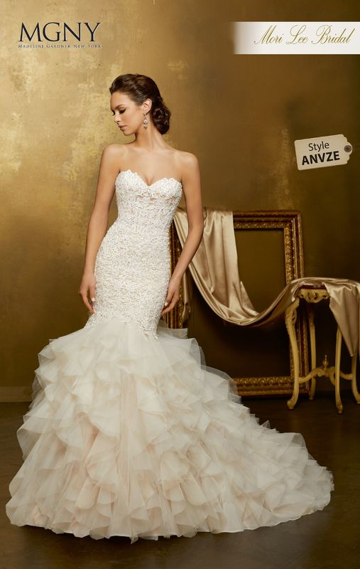 Style ANVZE Oksana  Crystal beaded, venice lace appliqués on a ruffled tulle mermaid  Matching satin bodice lining included