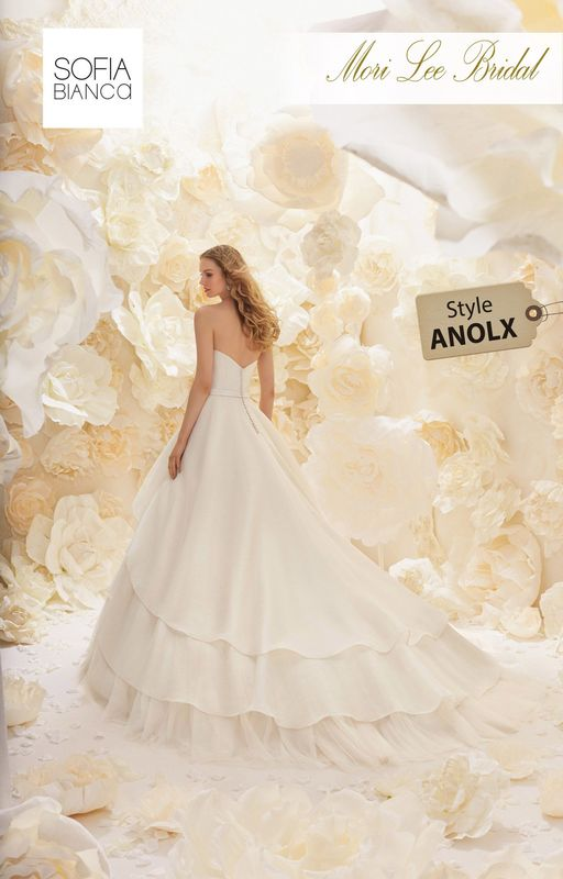 Style ANOLX A LAYERED ORGANZA BALL GOWN WITH STRAPLESS BODICE, MATCHING WAISTBAND, HANDMADE FLOWERS AND TULLE UNDERSKIRT  COLOURS WHITE, IVORY OR PALE BLUSH