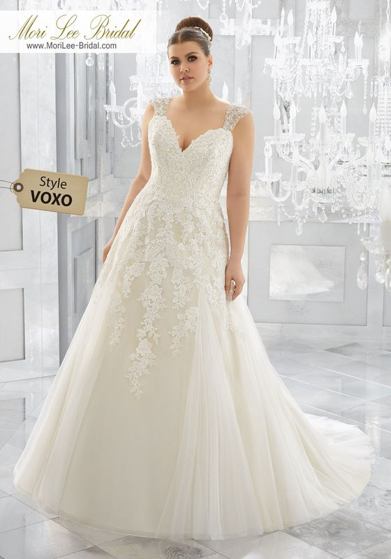Style VOXO Merah Wedding Dress  Timeless and Elegant, This Soft Tulle Wedding Gown Features Crystal Beaded, Embroidered Straps and Re-Embroidered Lace Appliqués Along the Bodice and Soft Tulle Godet Skirt. Colors Available: White, Ivory, Ivory/Light Gold.