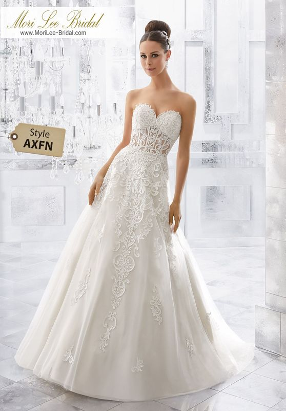 Style AXFN Marley Wedding Dress  Modern and Sophisticated, This Soft Tulle Wedding Gown Features Sculptured, Embroidered Appliqués with Frosted Beading That Accents the Sheer Bodice and Cascades Along to the A-Line Skirt. Matching Satin Bodice Lining Included. Colors Available: White, Ivory, Ivory/Light Gold.