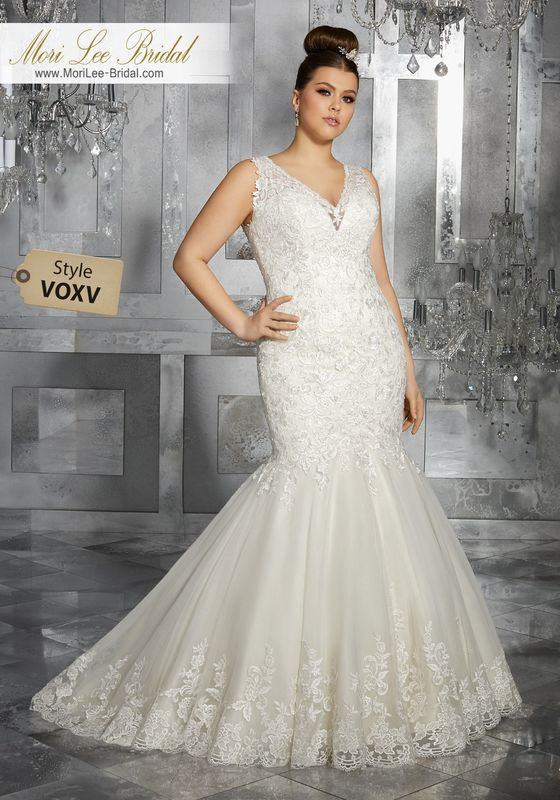 Style VOXV Minerva Wedding Dress  This Beautiful Slim Fit and Flare Gown Features Frosted Embroidered Appliqués and Exquisite Hemlace. An Illusion Back and Covered Button Detail Completes the Look. Available in Three Lengths: 55″, 58″, 61″. Colors Available: White, Ivory, Ivory/Light Gold.