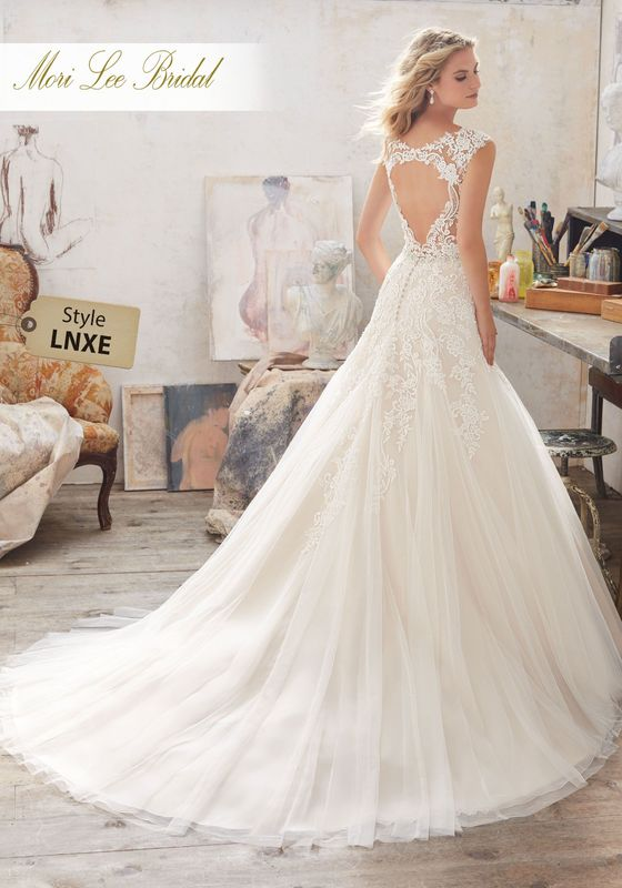 Dress style LNXE Marciana Wedding Dress Colors Available: White, Ivory, Ivory/Champagne. Shown in Ivory/Champagne.