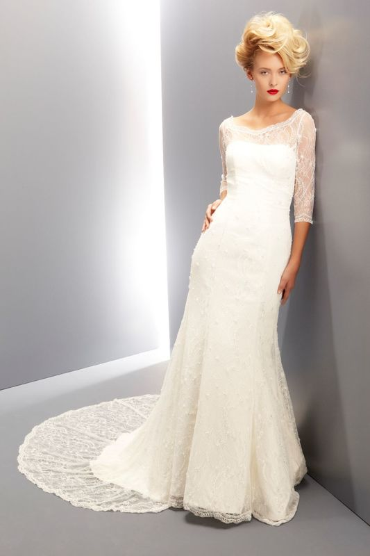 Ritva Westenius 'Delectable' Strapless gown with detachable cropped lace top with ¾ sleeves. Fabric is delicately hand-beaded fine Chantilly lace over satin.