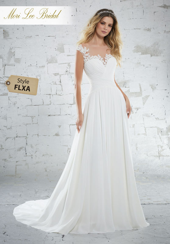Style FLXA Kamella Wedding Dress  Delicate Chiffon Wedding Gown with a Sweetheart Bodice. Diamanté Beading and Three-Dimensional Floral Embroidery Trim The Illusion Neckline and Cap Sleeves. Colors Available: White, Ivory