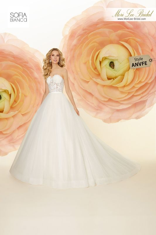 Style ANVFE Shauna  Embroidered lace appliqués on boned, corset bodice meets satin waistband with organza ball gown skirt  Matching satin bodice lining included