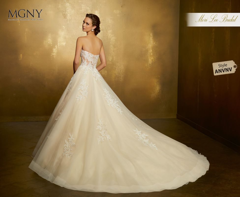 Style ANVNV Odette  Crystal beaded, embroidered lace appliqués on a tulle ball gown with boned, corset bodice  Matching satin bodice lining included