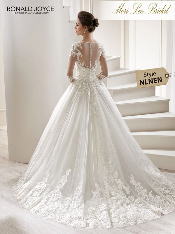 Style NLNEN LILITH A 3/4 LENGTH SLEEVED TULLE AND SPARKLE TULLE BALL GOWN WITH LACE MOTIFS AND ILLUSION NECK/BACK. PICTURED IN IVORY.  AVAILABLE IN 3 LENGTHS: 55', 58' AND 61'   COLOURS WHITE, IVORY