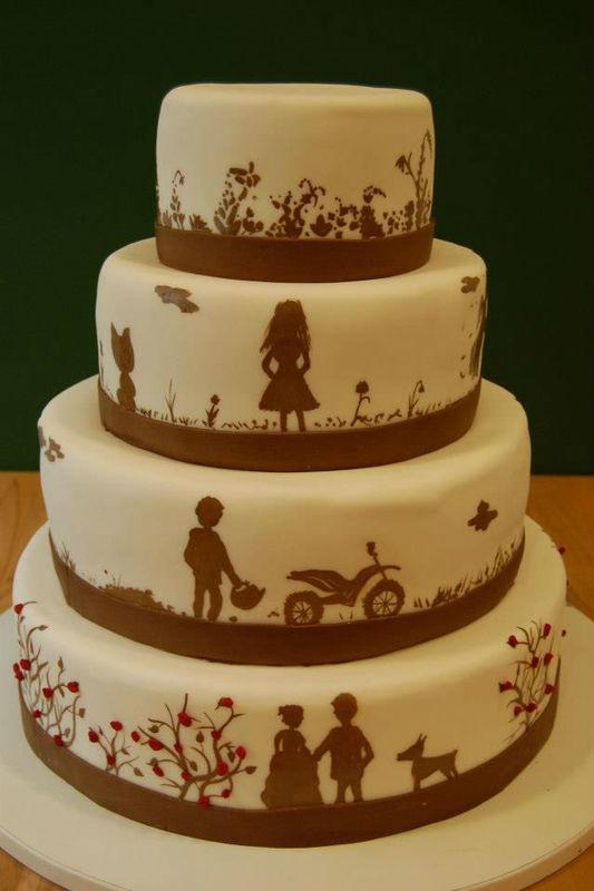 Beispiel: Hochzeitstorte mit Scherenschnittmuster, Foto: Unsere Hochzeitstorte.