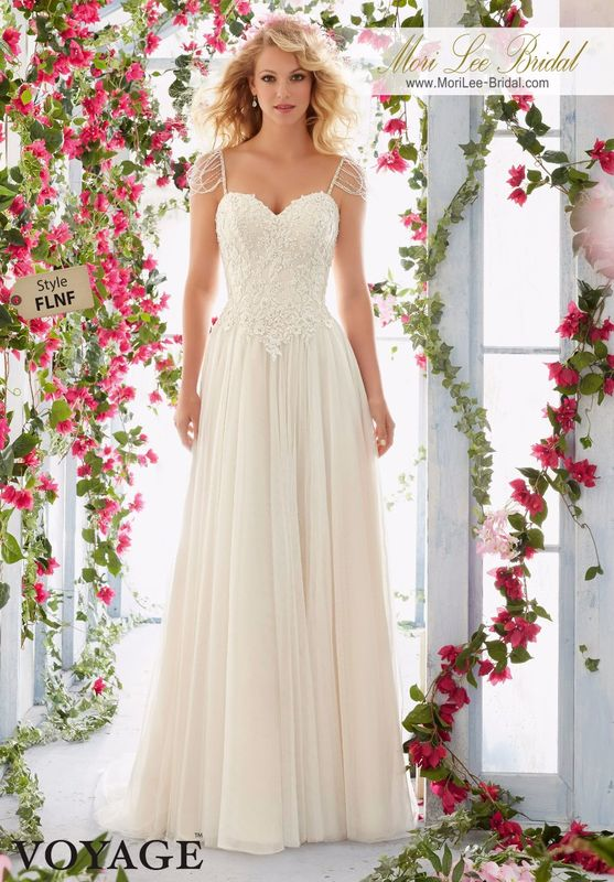Dress Style FLNF   Chandelier Crystal Beaded Straps Onto The Bodice With Embroidered Appliques On The Soft Net Gown