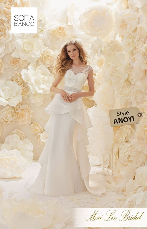 Style ANOYI A SLIM FIT ORGANZA GOWN WITH A LAYERED OVERSKIRT, A DIAMANTE AND PEARL ENCRUSTED WAISTBAND, EMBROIDERED BODICE AND ILLUSION BACK DETAIL  COLOURS WHITE / SILVER OR IVORY / SILVER