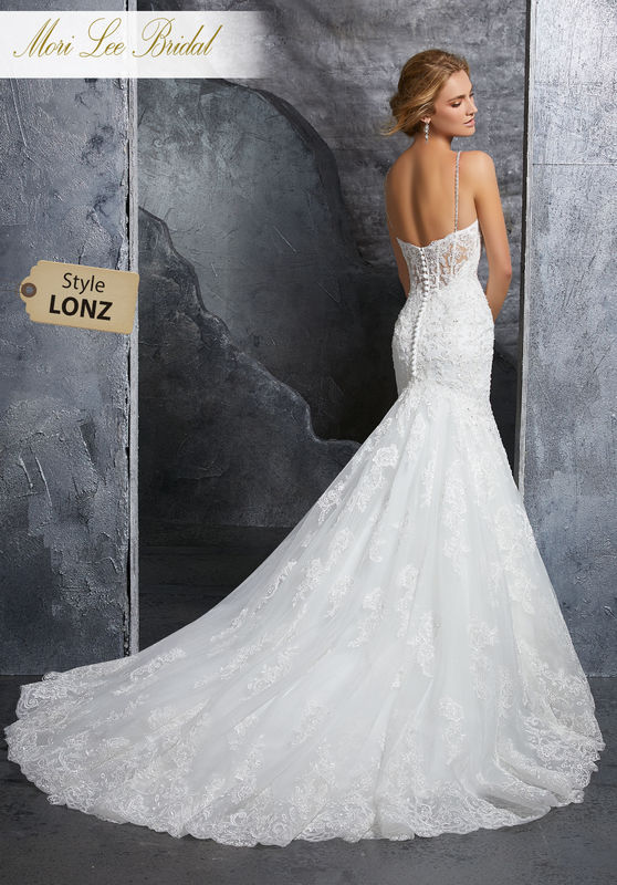 Style LONZ  Kenzie Wedding Dress  Timeless Fit and Flare Wedding Dress Featuring a Sweetheart Neckline and Crystal Beaded, Alençon Lace Appliqués on Net. Delicately Beaded Straps and an Exposed Boned Illusion Back Trimmed in Covered Buttons Complete the Look. Available in Three Lengths: 55″, 58″, 61″. Colors Available: White, Ivory, Ivory/Champagne