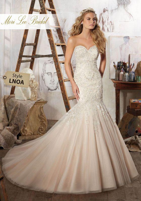 Dress style LNOA Mariela Wedding Dress Colors Available: White, Ivory, Ivory/Caramel. Shown in Ivory/Caramel.