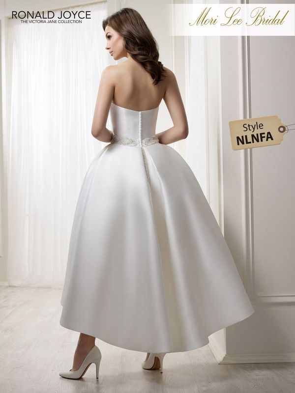 Style NLNFA LEAH A STRAPLESS MIKADO HI/LOW GOWN WITH BEADED BELT DETAIL. PICTURED IN IVORY.  COLOURS WHITE, IVORY