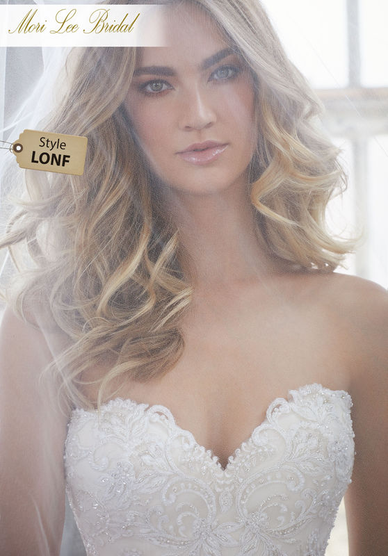 Style LONF  Khloe Wedding Dress  Fitted Mermaid Gown Featuring Delicately Beaded Embroidery with Scalloped Bands on Net. A Sweetheart Bodice and Exposed Boned Illusion Back Complete the Look. Available in Three Lengths: 55″, 58″, 61″. Colors Available: White, Ivory, Ivory/Champagne