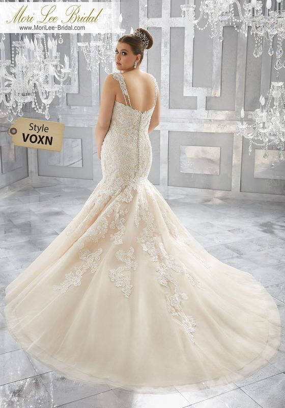 Style VOXN Musetta Wedding Dress  Crystal Beaded, Embroidered Appliqués Adorn the Figure Flattering Silhouette on This Tulle Mermaid Bridal Gown. A Layer of Sparkle Net Adds the Perfect Touch of Glam. Colors Available: White, Ivory, Ivory/Caramel.